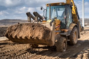 Industrial backhoe loader, details of excavation machinery on construction site